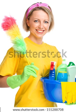 Young woman as a cleaning maid holding bucket full of liquids and static duster, isolated over white - stock photo