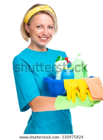 Young woman as a cleaning maid holding bucket full of liquids, isolated over white - stock photo