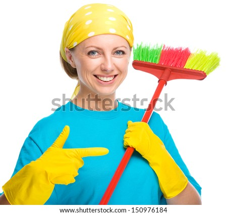 Young woman as a cleaning maid pointing to her broom, isolated over white - stock photo