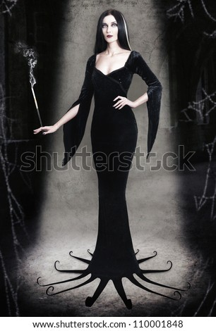Young woman as halloween witch with cigarette on dark background - stock photo