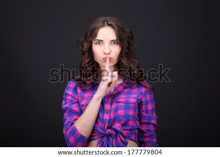 Young woman asking to keep silent  - stock photo