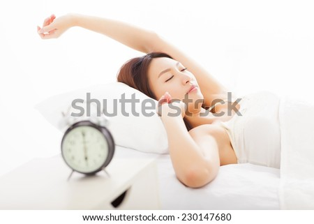 young woman asleep in the bed  - stock photo