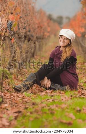 Young woman at Chilean vineyard  - stock photo