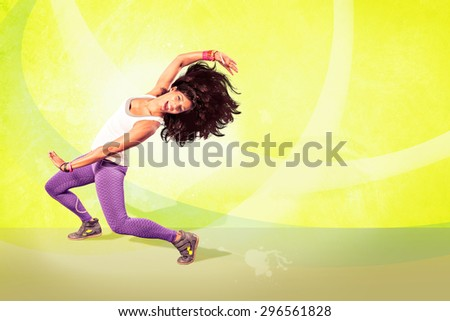 young woman at fitness exercise or aerobics dancing - stock photo