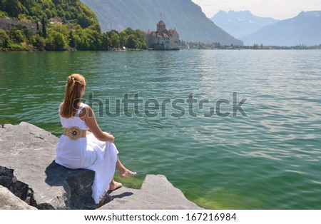 Young woman at Geneva lake, Switzerland  - stock photo