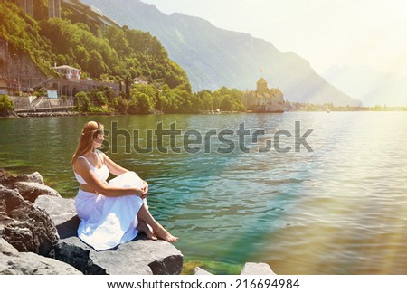 Young woman at Geneva lake, Switzerland - stock photo