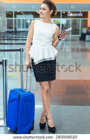 Young woman at international airport. Female passenger at terminal, indoors.