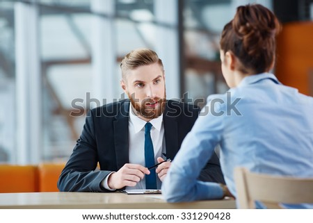 Young woman at job interview - stock photo