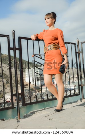 Young woman at quay - stock photo