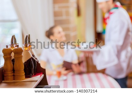 Young woman at restaurant sitting at table