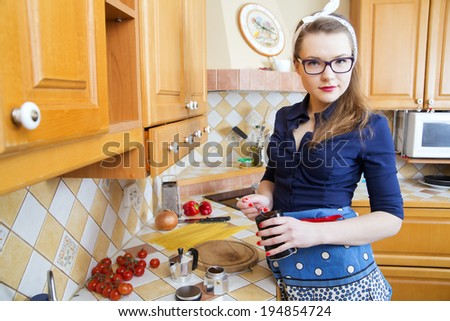 Young woman at sexy suit hold coffee can - stock photo
