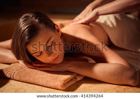 Young woman at spa massage - stock photo