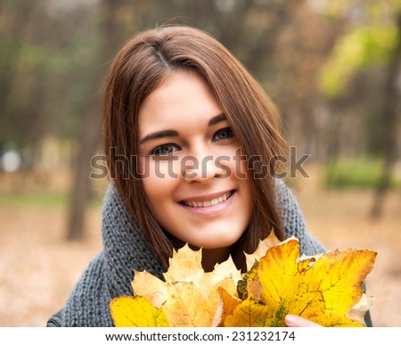 Young woman at the autumn park. - stock photo