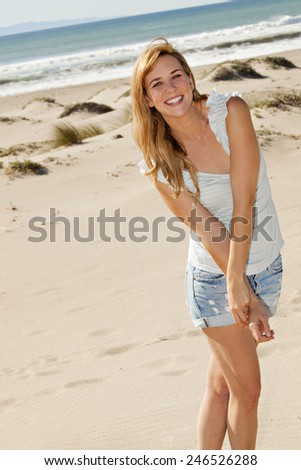 Young woman at the beach on a sunny day - stock photo