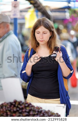 Young woman at the farmer market  - stock photo