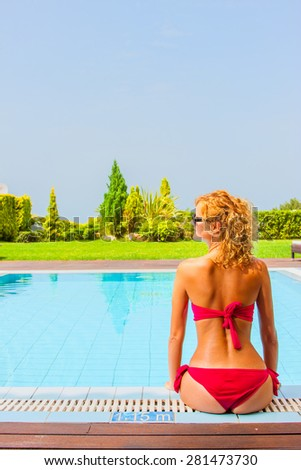 Young woman at the swimming pool - stock photo