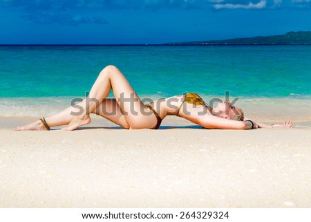 young woman at the tropical sand beach