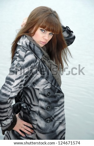 Young woman at the water - stock photo