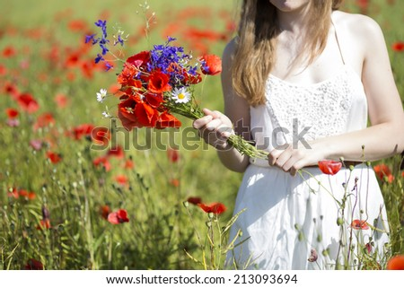 Young woman at white dress with zoomed bouquet - stock photo