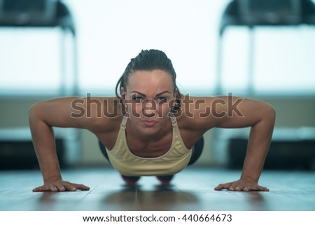 Young Woman Athlete Doing Pushups As Part Of Bodybuilding Training
