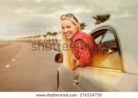 Young woman auto traveler on the highway - stock photo