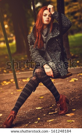 Young woman autumn portrait. - stock photo