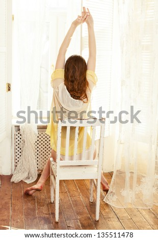 young woman awakening in the sunny morning - stock photo