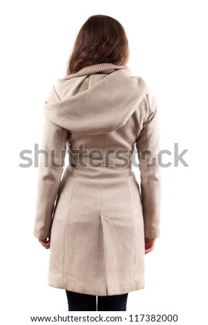 Young Woman Back In Beige Coat - stock photo
