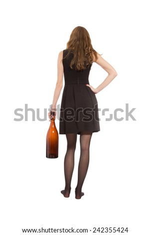young woman back with empty alcohol bottle isolated on white background - stock photo