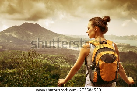 Young woman  backpacker traveling along mountains, happy female walking in the island to Bali, discovering world, summer vacation concept - stock photo
