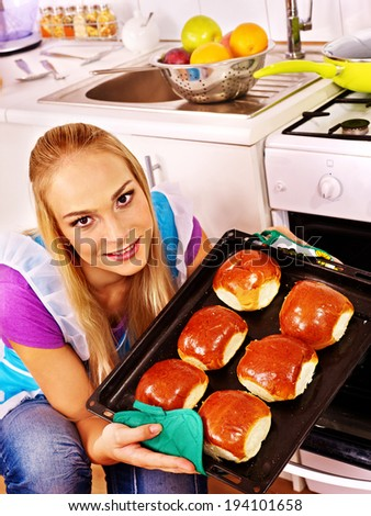 Young woman bake cookies. Kitchen. - stock photo