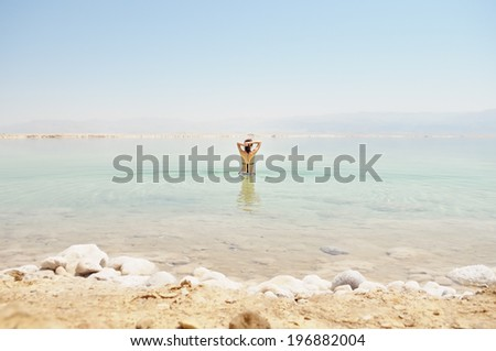 Young woman bathe at the Dead Sea, Israel  - stock photo