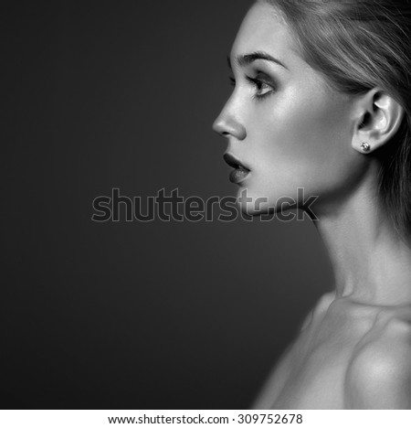 Young woman.Beautiful blonde Girl.close-up fashion monochrome portrait - stock photo