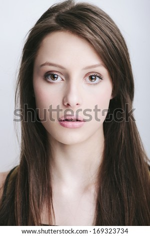 Young woman beauty portrait. Natural soft make up.  - stock photo