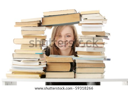 Young woman behind books, isolated on white background