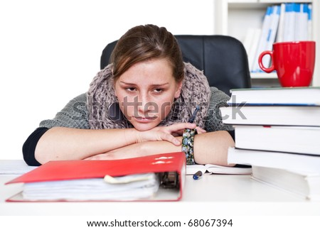 young woman being bored staring over her books and notes - stock photo
