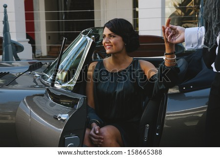 Young woman being escorted out of her vehicle - stock photo