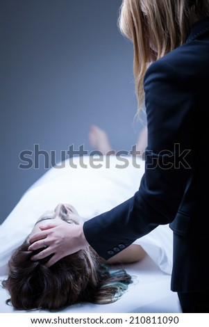 Young woman being in deep mourning after death of relative - stock photo