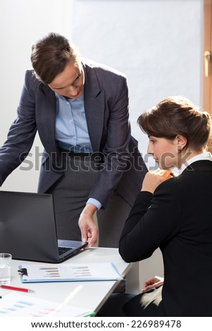 Young woman being on work experience in office - stock photo