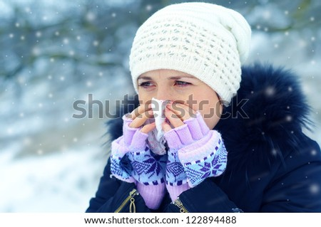 young woman blow one's nose - stock photo