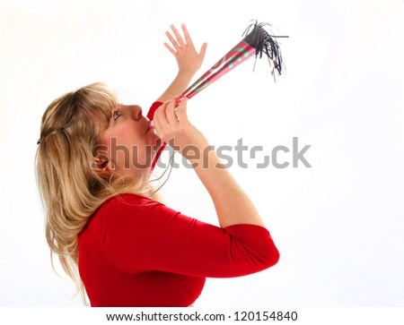 Young woman blowing horn at New Year's eve party