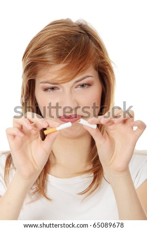 Young woman braking cigarette, isolated on white - stock photo