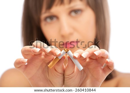 Young woman breaking a cigarette - close up of her hands