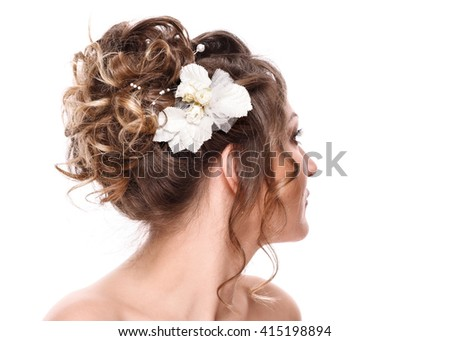 young woman bride with beautiful hairstyle and stylish hair accessory, rear view. Isolated on white background. - stock photo