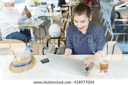 Young Woman Browsing Internet Laptop Concept