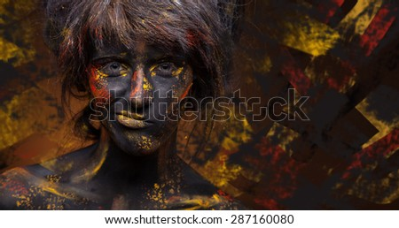 Young woman brunette with bright face orange and yellow art on colorful background - stock photo