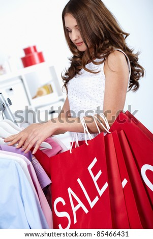 Young woman buying things at sales period - stock photo