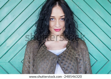 Young woman by the old door - stock photo
