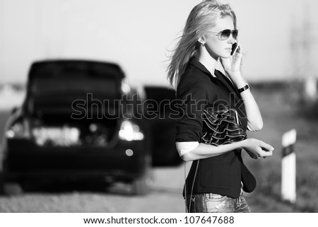 Young woman calling for help - stock photo