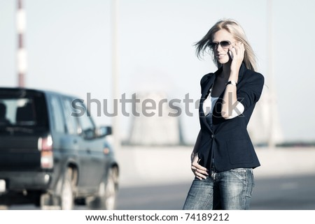 Young woman calling on the phone - stock photo